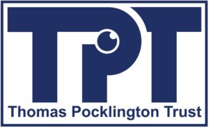Thomas Pocklington Trust logo; Large TPT letters with the words Thomas Pocklington Trust underneath enclosed in a rectangle. Letters, words and the rectangle border are a dark blue. Within the P of TPT is a small round eye looking upwards.